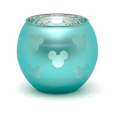 Create an atmospheric Disney glow at home with our Disneyland Paris Mickey Mouse tealight holder. The clear glass has cut-out shapes in its metallic layer, casting Mickey silhouettes on the walls once lit. Mickey Mouse, Minnie, Disney Wedding Shower, Toddler Themes, Mickey Silhouette, Snow White Disney, Cut Out Shapes, Disney Home Decor, Disney Fun