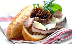 A heavenly meal: tender slices of steak, Gorgonzola cheese, rocket and onion marmalade in crusty baguettes. Braai Recipes, Meat Recipes, Dinner Recipes, Cheese Roll Recipe, Posh Nosh, Steak Rolls, Cheese Rolling, Savory Snacks, Cheesesteak
