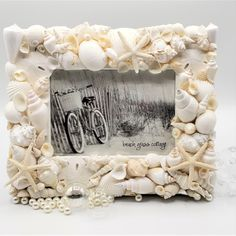 Artisan handmade white seashell frame, coastal decor shell photo frame perfect for seashell decor, seashell gifts, beach gifts. Seashell Picture Frames, Seashell Frame, Baby Photo Frames, Beach Frame, Starfish, Seashell Crafts, Beach Wedding Gifts, Seashell Wedding, Bridal Gifts