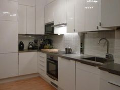 These high gloss white cabinets from Ikea are going in the kitchenette.