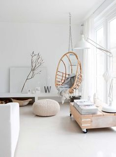 White living room with rattan hanging chair