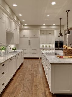 Clean, simple, all-white kitchen by Shuffle Interiors