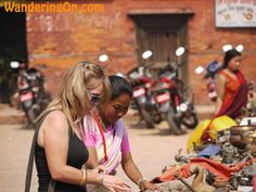 How To Haggle: Noelle haggling with a Tibetan lady in the market in Durbar Square, Patan, Nepal