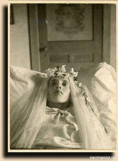 Post Mortem Photography. This photo is very eerie as her eyes are open!