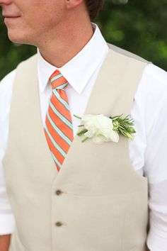 Orange and teal tie. Fresh! Love the cream brown cover