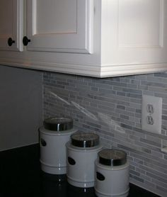Adding moldings to cabinets - dresses up plain cabinets inexpensively! KEEP THIS PIN.   good cost break down and nice tips.  Love the molding above the cabinets.  I will have to do this.