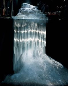 Pennsylvania-based artist Steve Tobin is known for pushing the limits of every material he has ever touched. Though he's usually known for his large scale bronze and steel sculptures, Tobin is equally adept at creating frozen waterfalls and rivers with rip roaring ends. His series Waterglass is made up of stunning sculptures composed of 2 to 4 million discarded capillary tubes. With some rivers measuring up to 100 feet long, they're majestic displays of art that all mimic nature.