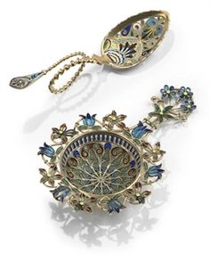 A NORWEGIAN SILVER-GILT AND PLIQUE-A-JOUR ENAMEL TEA STRAINER