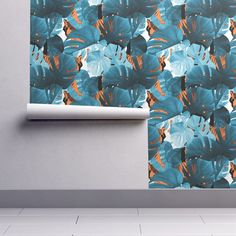 Isobar Durable Wallpaper featuring Blue Monstera Leaves and Tigers in the Jungle pattern by Minikuosi. Roostery Home Decor wallpapers.