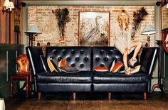 Poppy Delevingne is Fun and Flirty for Xavi Gordo in Elle Spain April 2013 brick wooden floor blk leather couch