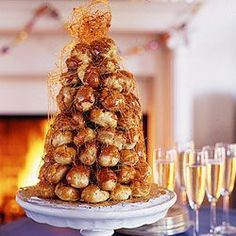 Croquembouche - Ambitious enough? someday you'll all come to my house for dinner and i'll pull out this baby for dessert :D