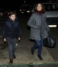 The stylish 45-year-old Princess Mary looked both cosy and chic last weekend, when she attended a football match with her husband, Prince Frederik, and son, Christian (pictured)