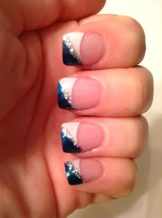 French tip nails with blue and glitter design.