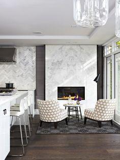 Marble herringbone tile and fireplace.