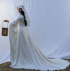 bridal gown in silk satin, inspired by 12th century fashions.
