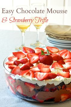Easy Chocolate Mousse Strawberry Trifle - the easy chocolate mousse is in this strawberry trifle is really just chocolate and whipped cream but it is the perfect, unfussy complement to chocolate scratch cake and fresh strawberries in this tempting dessert. Great for feeding the weekend BBQ crowd too!