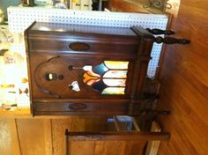 1920's radio cabinet with stained glass. The first radio invented was very useful in the 1920's because in 1923 over 60% of Americans purchased a radio. During the 1920's the radio was used just a television is used in the current century we are in. The main reasons for owning a radio was to be informed by most national news, listen to many sports games, and listened to some plays.