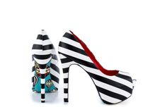 Sydney - Sail away in the Sydney and leave your cares behind! Black and white stripes highlight the leather upper, stiletto heel and peep toe platform. A pretty bright blue sky and playful hot air balloons float on the sole. The sky's the limit in the Sydney!   Taylor Says