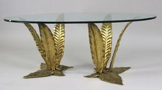 Table basse attribuée à Maison Charles. Plateau en verre et piètement en bronze. Disponible chez www.collectionofdesign.com