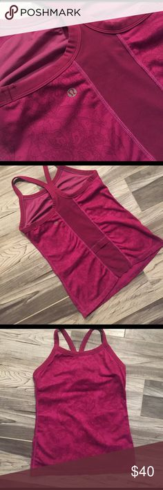 Lululemon razorback top Cute pink razor back top size 4. Has floral top please see pics. Bra pads have been removed. lululemon athletica Tops Tank Tops