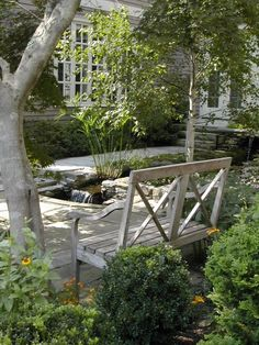 A bench in the shade and the gentle sound of a waterfall fills this courtyard and creates a peaceful spot for relaxing.