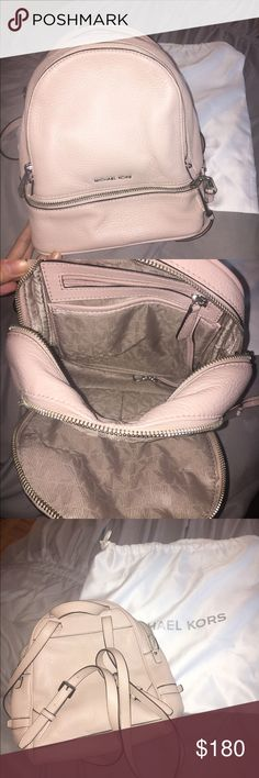 """Michael Kors RHEA SMALL LEATHER BACKPACK This is in absolutely perfect condition and brand new . It is a gorgeous baby pink color and on trend . Comes with dust bag. Color is dusty rose .  -100% Cow Leather  -Silver tone Hardware  -10"""" X 11.75"""" X 4.5""""  -Lining: 100% Polyester  - Michael Kors Bags Backpacks"""