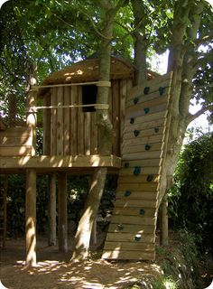 'Playful' treehouses by Treehouse Life, nestled amongst three trees with adventurous Climbing Wall, Rope Bridge, a swing bar with 3 Swings, Hammocks and packed with fun.