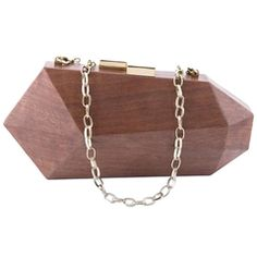 A beautiful contradiction to the Art Deco movement of linear symmetry, the Fractal Wooden Clutch combines materials of the Art Deco era, lacquered wood and. Brown Leather Purses, Brown Purses, Wooden Calendar, Wooden Purse, Art Deco Movement, Clutches For Women, Beaded Bags, Art Deco Era, Handmade Bags