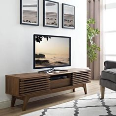 Bring a chic, minimalist vibe to your interior space with the Modway Render 59 in. TV Stand , designed in mid-century style with clean, angular. Living Room Tv, Living Room Furniture, Modern Furniture, Apartment Furniture, Tv Furniture, Apartment Ideas, Walnut Furniture, Furniture Stores, Garden Furniture