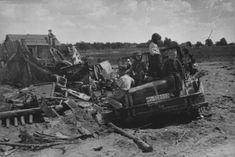 "Soviet children play on the broken German car ""Horch"" (Horch) 108 type 40. Next to the broken fence 20 mm anti-aircraft automatic gun FlaK 38"