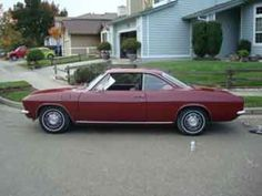 A 1967 Corvair Coupe   Like my big brothers - gee sorry did not see that fence bro...knew I shoulda asked ya first...