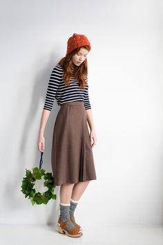 crop thin stripped blue and white pullover, brown, gray,cocoa skirt, dark gray knit socks, light brown leather flats or oxfords