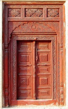 The Moghul Door, Lok Virsa, Islamabad The typical Moghul entrance door with carving and motifs. These type of doors are still being produced in Pakistan and sold for bungalows and commercial shops. Cool Doors, Unique Doors, Knobs And Knockers, Door Knobs, Entrance Doors, Doorway, The Doors Of Perception, Traditional Doors, Types Of Doors