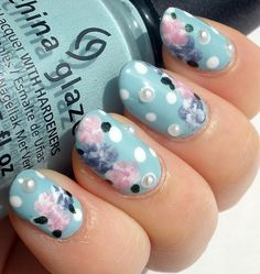 Appliques are a big trend for spring, try using pearls with flower nail art!