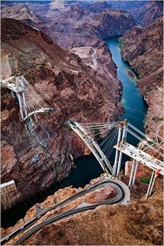 This shot was taken from a helicopter at dawn in May. The new four-lane bridge will mean that commercial vehicles traveling between Phoenix and Las Vegas will no longer take the winding, narrow roadway, built in 1936, that leads across the dam. Photo: Jamey Stillings for The New York Times