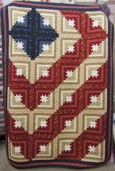 """""""...o'er the land of the free, and the home of the brave."""" Our patriotic red, white, & blue Log Cabin Americana Lap quilt kit measures 58"""" x 82"""" including pattern and binding. (It's a bit Civil Ware era too because of the fabrics our designer picked.)"""