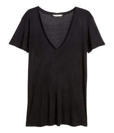 Short-sleeved top in soft jersey with silk content. Low-cut V-neck at front.