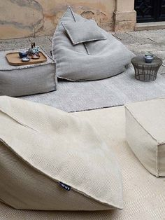 Do not let the simple form of the Sail Pouf fool you; once you sit in it, you may never want to get up. With this pouf, your body will be cocooned in a soft textured wool fabric weave stuffed wit Garden Furniture, Furniture Design, Luxury Furniture, Furniture Ideas, Outdoor Furniture, Futons, Daybeds, Floor Seating, Garden Seating