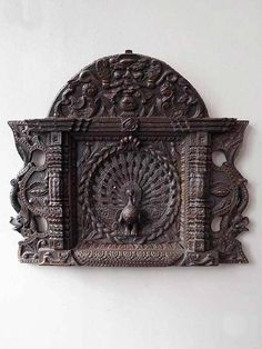 An extremely finely carved peacock surrounded by dragons and an image of Yama, the lord of death, in dark wood and made to hang on the wall. Wooden Wall Panels, Wooden Wall Decor, Wooden Walls, Wood Wall Design, Carved Wood Wall Art, Wood Carving Designs, Most Beautiful Gardens, Hotel Decor, Marble Art