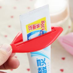 2Pcs Lip Kiss Bathroom Toothpaste Dispenser Facial Cleanser Tube Cream Squeezer  This toothpaste dispenser is made of ABS plastic and it is durable tough and reusable. It can squeeze any tube item, such as toothpaste, facial foam, tube cream, tube gel. It is a great helper for your bathroom and save your time when the toothpaste becomes running out. This creative invention can help you to save paste and avoid wasting :)