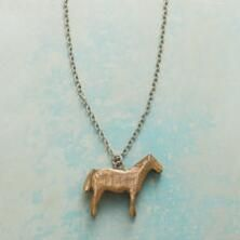 The bronze pony suspended from this sterling silver necklace tugs at the heartstrings of any equine lover.