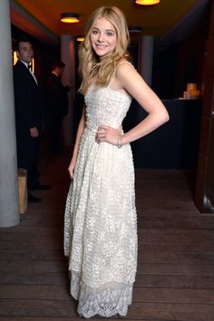 Chloe Moretz flows in Chanel's white, lace gown.