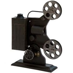 """Weathered metal projector décor in black.   Product: Projector décorConstruction Material: MetalColor: BlackDimensions: 19"""" H x 14"""" W x 4"""" D"""