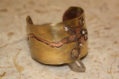 Mighty Copper and Brass ! by Elaine Marie on Etsy.  My  reticulated brass and copper cuff is featured in this Treasury.  The cuff shown here is from SDL Studio.