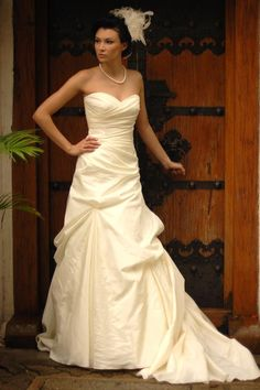Wedding Gown By Augusta Jones. Style - Bobbi size 10 in Cream. A strapless ruched A-line gown featuring pickups on the skirt and train  #MacysBridalSalon #chicago #bridal #gown #weddingdress #augustajones