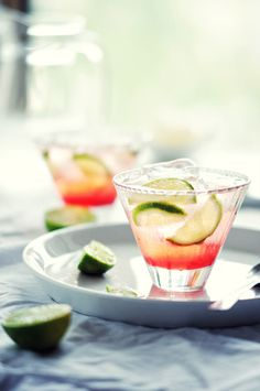 Vodka + Cranberry juice + top with soda water or club soda and to finish, garnish with freshly sliced limes