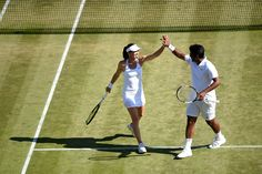 Leander Paes and Martina Hingis celebrate during their quarter-final mixed doubles match. Florian Eisele/AELTC Wimbledon 2015
