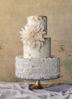 Sugar flower dahlia on a wedding cake. Maggie Austin Cake signature frill layered cake. Beautiful wedding cakes.