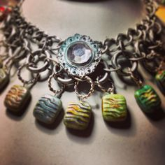 Ocean wave necklace made with antique silver chain and ceramic beads