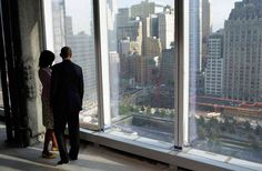 The president and First Lady looking down onto the 9/11 memorial | The 45 Most Powerful Photos Of 2012